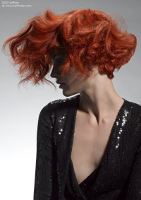 red curly hair behind her ear