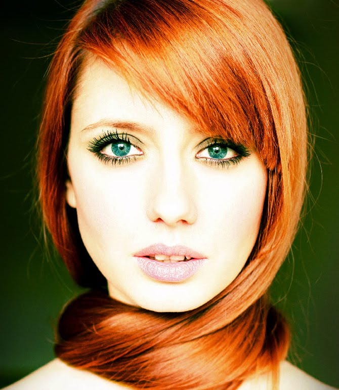 Emerald green eyes and red hair