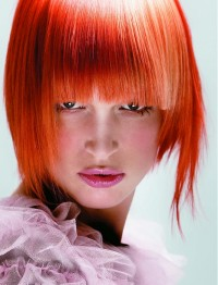 reddish orange hair with bangs hairstyle