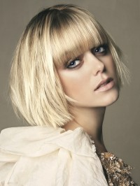 sleek blonde bob with bangs