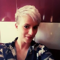 Short, blond hair with asymmetrical fringe and shaved sides