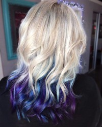 Blond, long, curly hairstyle with purple and blue endings