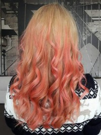 Long blond hair with red highlights and curls