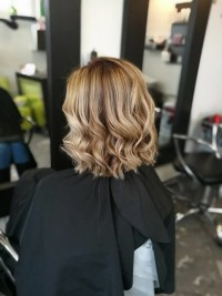 Medium, blonde, curly hairstyle