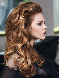 Long, brown, curly hair with blond highlights