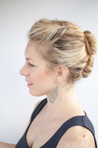 Long, blond hair tied in a bun