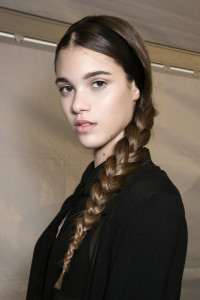 Long, brown hair with a single thick braid