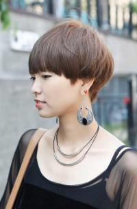 Short, brown, cropped hair with short fringe and a bob's effect
