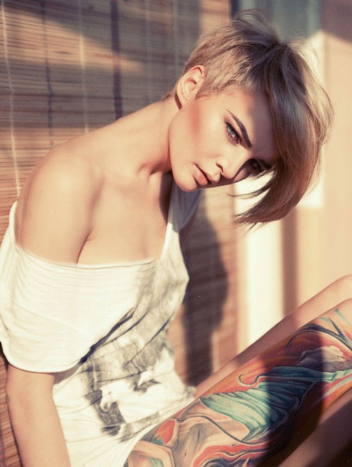 Short, straight, asymmetrical, blonde hair with long fringe