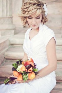 Short, blonde, curly hairstyle for a wedding