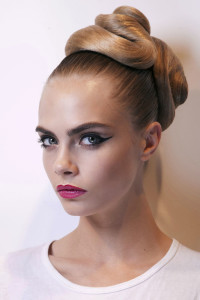 Long, blonde hairstyle with swept back hair and fancy tied buns