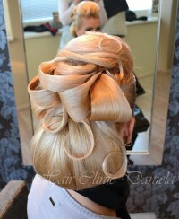 Fancy tied long, blonde hair with a lot of waves and buns