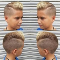 A unique looking hairstyle with shaved sides and spiky fringe with an ombre effect