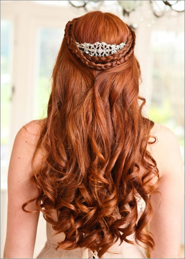 Long, red, wavy hairstyle with braids for wedding