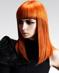 Long, straight, red hairstyle with brow skimming fringe