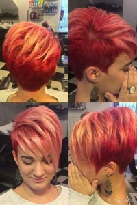 Short, cropped, red hairstyle with wispy fringe and blonde highlights