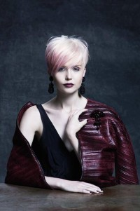 Elegant, short, cropped , blonde hairstyle with wispy fringe and pink reflections