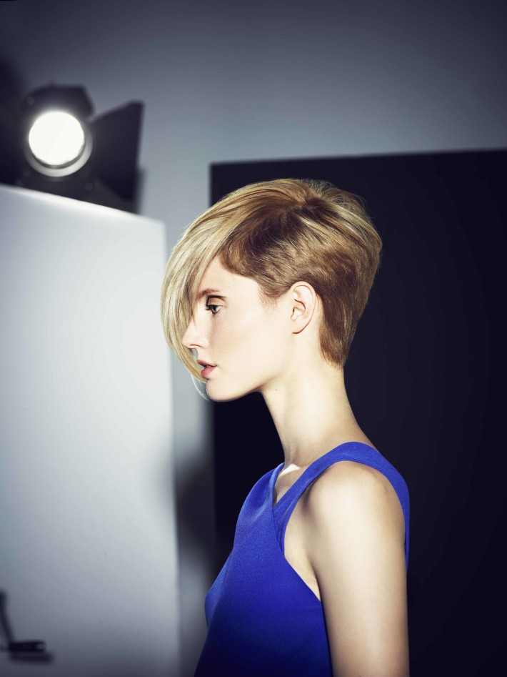 Short, cropped, bob hairstyle with trimmed sides and long, blonde bangs