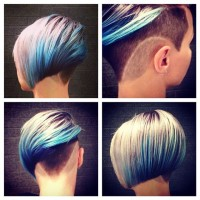 Short, cropped, bob hairstyle with trimmed sides, shaved pattern and white- blue highlights