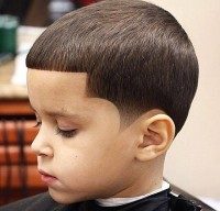 Regular cutting hairstyle for boys with baby fringe and patterned sides