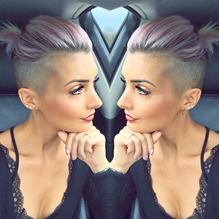 Short, cropped, blonde hairstyle with tied, swept back hair and trimmed sides
