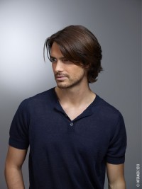 Medium, brown hairstyle for men with longer bangs and beard
