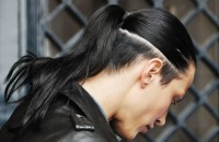 Long, dark hairstyle with shaved pattern and a pony tail