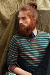 A woodcutter style for red haired guy with a bun and long beard