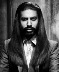 Long, straight hairstyle with swept back hair and beard