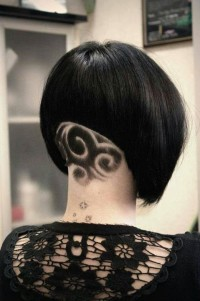 Short, bob looking hairstyle with shaved, back design