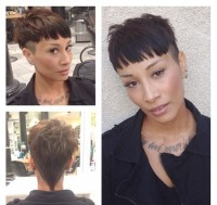 Short, brown haircut with shaved sides and blunt bangs