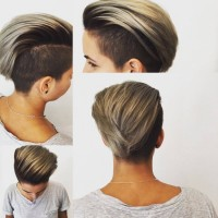 Short brown haircut with layered, blonde fringe and trimmed dark sides
