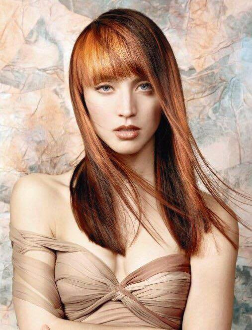 Long Dark Blonde Haircut With Blunt Bangs And Blonde Highlights