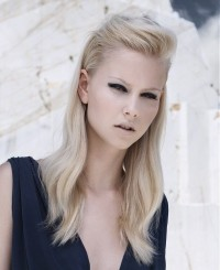 Long, blonde hairstyle with tied locks and swept back bangs