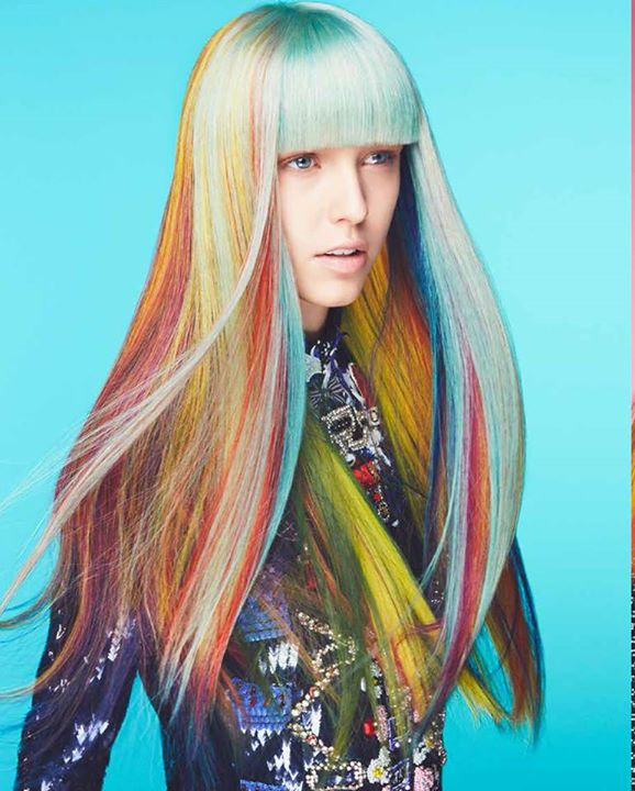 Long, multicoloured hairstyle with blunt bangs and highlights