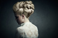 A beautiful hairstyle for wedding with long, blonde hair tied locks and buns