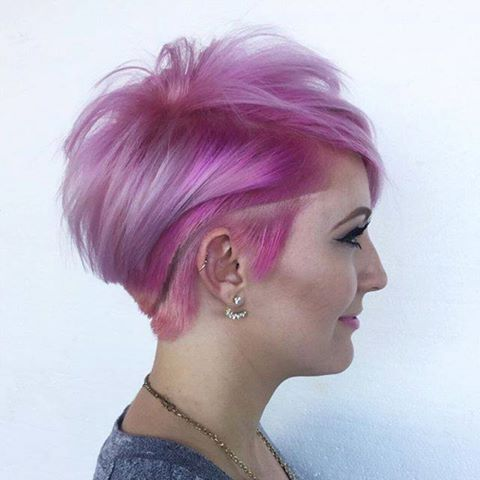 Short pink hairstyle with shaved sides and pattern