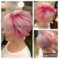 Short, bob style hair with pink highlights