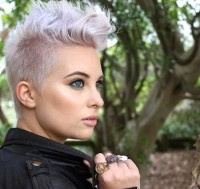 Short platinum hairstyle with trimmed backs and spiky fringe