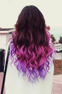 Amazing looking pink ombre hairstyle with dark purple top and wavy, pink coloured endings
