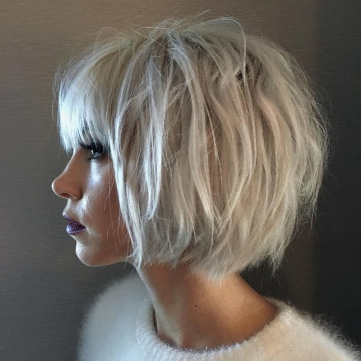 Short, thick, bob style, platinum hair with blunt bangs