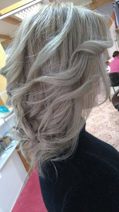 Medium, wavy, platinum hairstyle