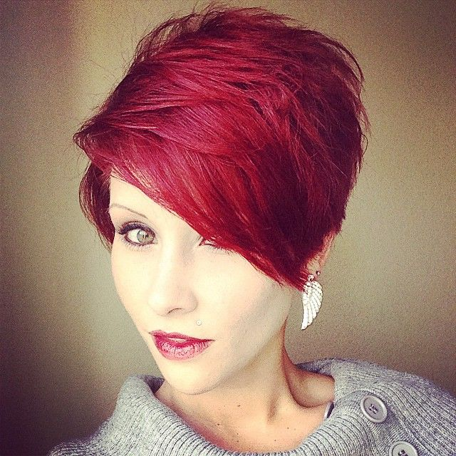 Short, red, bob hairstyle with longer side swept fringe