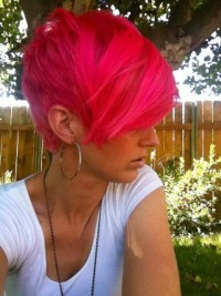 Short, neon pink hairstyle