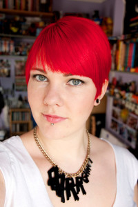 Pixie looking, red hairstyle with baby fringe