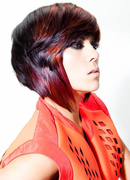 Short, red hairstyle with longer sides and side swept fringe
