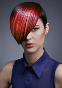 Short, red hairstyle with long, coloured bangs and short, dark sides