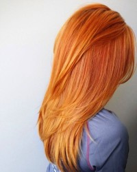 Long, straight, carrot red hairstyle