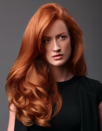 Long, natural, wavy, copper hairstyle with side-swept hair