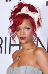 Rihanna's red hairstyle with a fancy bow in a pin-up style